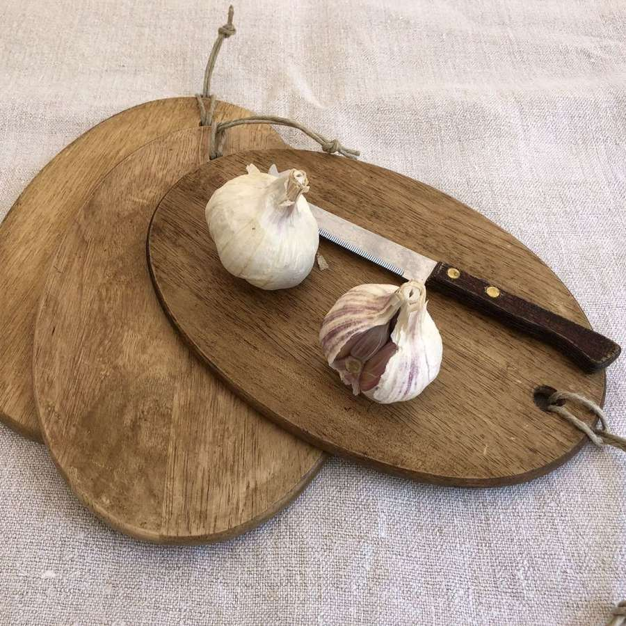 Wooden boards with hanging string tags